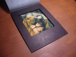 Gouache painting of a lion with abstract strip across his eye by Adam Miconi